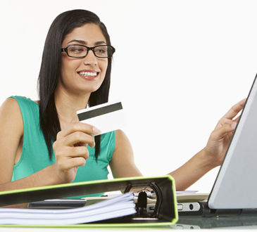 Woman with laptop and credit card