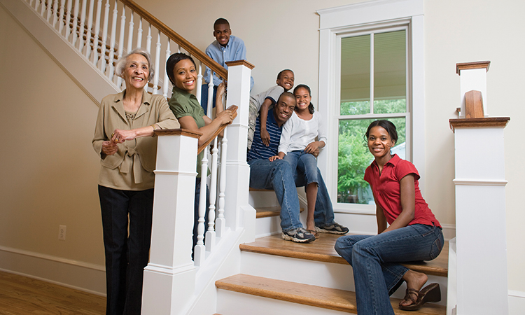 Family portrait on stairs in new home