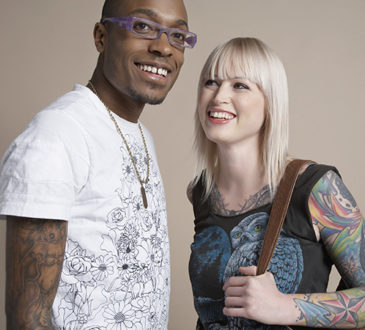 Portrait of young man and woman smiling
